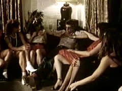 John-holmes-gives-blowjob-lesson-to-group-of-girls