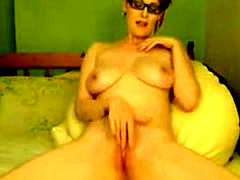 Nerdy Redhead with big tits fucks pussy with fingers and vibe