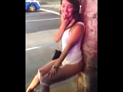 shy girl peeing against a tree