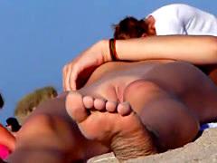 Hot teen tanning nude on the beach
