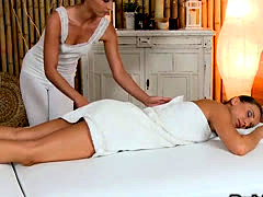 Masseuse rubs and oils sexy brunette