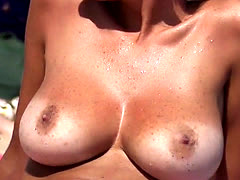 Wonderful busty girl Topless on the Beach