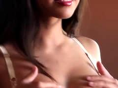 busty brunet fingering her pussy