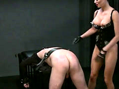 Busty mistress spanking dude in bdsm slave flogging