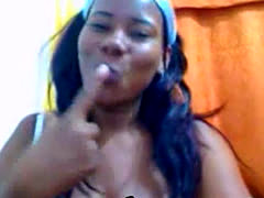 Brunette ebony with huge natural tits titfucking with sex toy