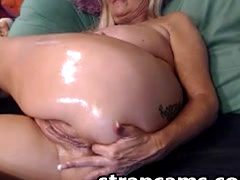 Blonde granny with oiled body toying pussy on webcam