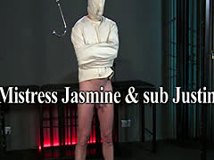 Slave in straitjacket gets handjob to orgasm
