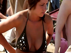 Gorgeous busty girl goes Topless on the Beach