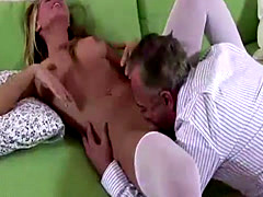 Older British dude licking stocking wearing younger blonde's pussy