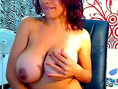 Latina with curly redhead hair plays with huge tits and pussy on webca