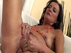 Granny plays with her pussy