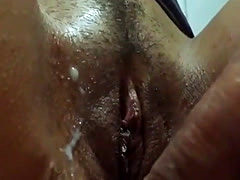 Slut rubs a cock on her pussy until it cums hard