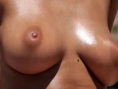 Fantastic busty brunette Topless on the Beach