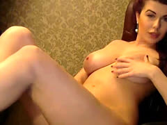 Delectable redhead busty camgirl in front of a webcam
