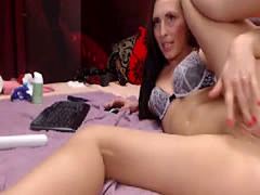 Brunette camgirl with juicy ass and two vibrators on webcam