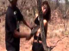 Stunning African slut bonded and abused on the safari