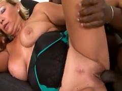 Busty granny Sarah filled by black rod on couch