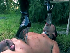 Femdom pegging submissive outdoor in mud