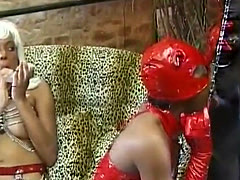 Two amazing ebony sluts in leather outfits fucking tiedup guy