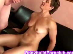 Female bodybuilder with strong body and short hair bounces stiff cock