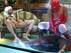 African stud gets abused by dominatrix in latex