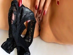 Hot chick plays with panty