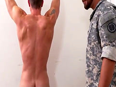 Horny sergeant makes one soldier fuck another soldier while he is watc