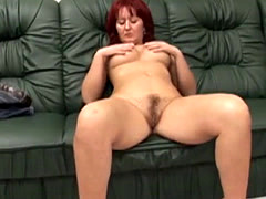 Redhead slut gets cunt filled by amputee on couch