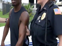 Two very horny female police officers take turns on black man's la
