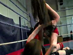 Dyke babe strapon fucking a wrestling beauty