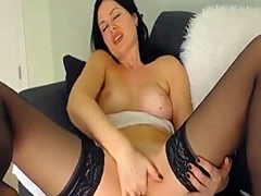Lovely dark haired beauty self pleasuring display on webcam