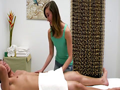 Slutty Asian masseuse plays with the oiled cock of a dude