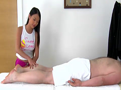 Asian girl gets impaled on a guy's cock on a massage table