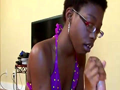 Nerdy ebony gives awesome handjob
