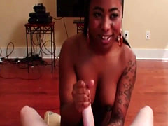 Busty Ebony tugs dick until cumshot