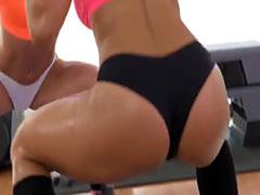 Sporty lesbians enjoying a hot fingering after workout