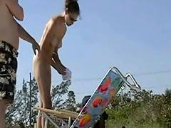 Dark haired nudist  spied pissing on the beachvoyeur voyeur video