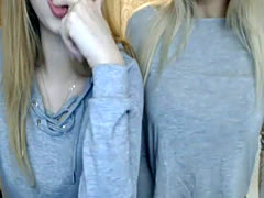 Two cute sisters dance and tease on a live cam