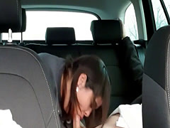 Young mom giving a blowjob in the car
