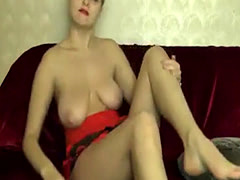 Sexy blonde with nice big tits puts her horny pussy on webcam display