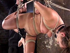 Crotch roped brunette gets waxed