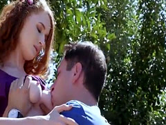 Gorgeous ginger Abbey Rain gives head and gets fucked outside