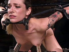 Babe ass caned in metal bondage device