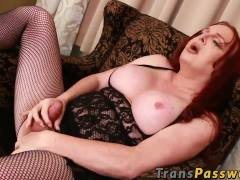 Big and busty tranny in fishnet stockings masturbates