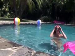 Sweet gal plays on a water mattress