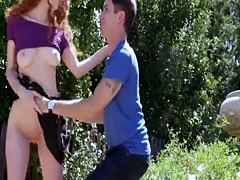 Slutty redhead rides a big cock out in the public park