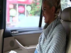 Tanned sexy blonde takes cock in taxi