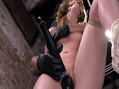 Hogtied brunette shocked and caned