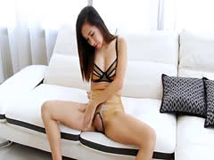 Sexy brunette shemale fucks her big cock with fleshlight