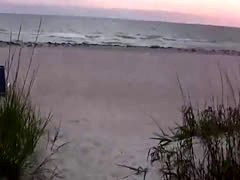 Irresistible chick strip down on the beach